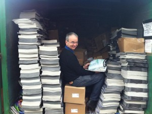 Ben amidst towers of documents