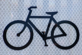 black graphic of a bicycle