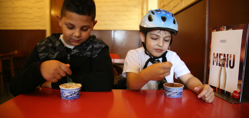 Marek and Ianco in a cycling helmet at the Queens cafe - 8 year olds eating ice cream