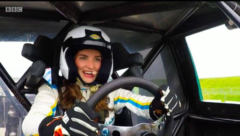 Racing car driver behind the wheel