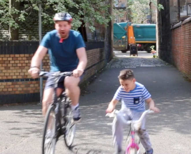 Lewis and a boy on bikes