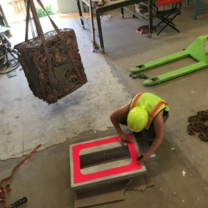 Lily Cox-Richard working on a copper cube